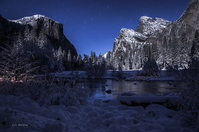 Granite towers of Yosemite illuminated in full moonlight