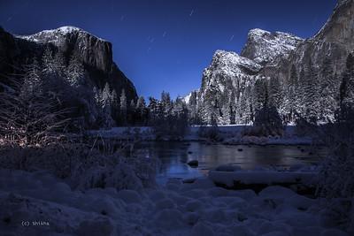 Granite towers of Yosemite illuminated in full moonlight