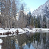 Cook's Meadow is surrounded by mountains. Merced River