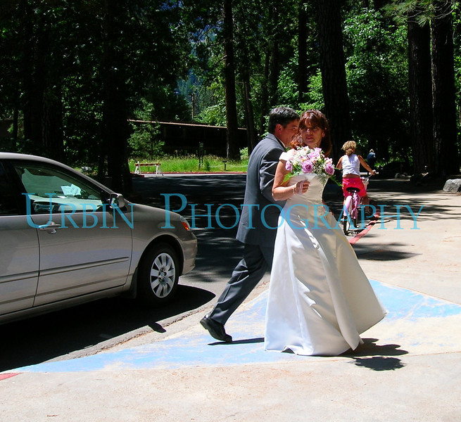 A bridge and groom on their way to their wedding reception at the Mountain Room