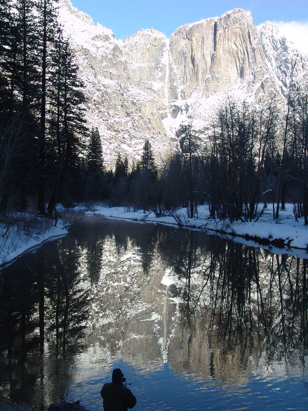 Photographer at Swinging bridge Yosemite winter
