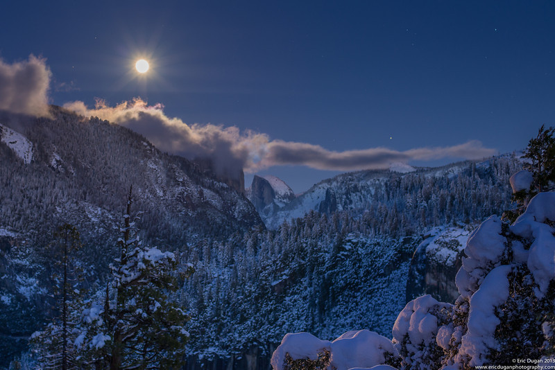 Yosemite Moonrise<br /> A cold December full moon rising up over Half Dome in Yosemite Valley.  El Capitan is obscured by clouds.