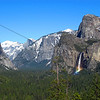 Famous view from the Yosemite tunnel.  This view features a rainbow at the base of Bridal Veil Falls and a snow capped Half Dome and Clouds Rest.