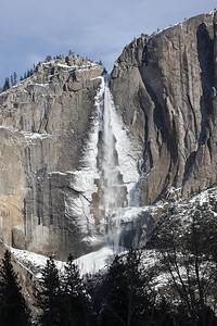 Ice forms behind the fall at night in the winter months.  As the sun warms the ice, it breaks and falls.  Hearing the noise it makes is similar to hearing thunder.  The ice cone also forms at the base during the winter months. Yosemite National Park February 21, 2011 F21(17)