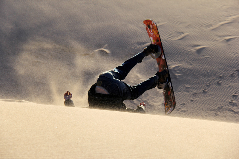 IMG_1909 Pro tip: if you want to snowboard down the sand dunes, you need some momentum...  thankfully he was not hurt.