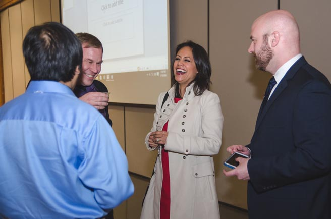 Cynthia Izaguirre meets attendees at the Young Catholic Professionals Executive Speaker event on Jan. 19. (Photo by Adrean Indolos / NTC)