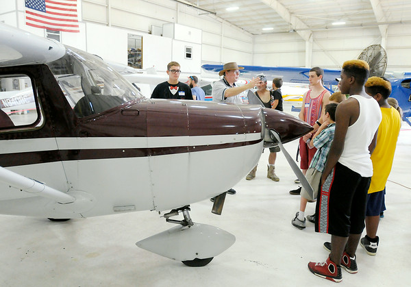 Don Knight | The Herald Bulletin<br /> Youth learn about aircraft before taking a free plane ride as they participate in the Experimental Aircraft Association Chapter 226's Young Eagles program at the airport on Saturday.