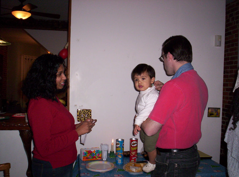 The family moves in first - Charmaine, Matthew and Mark Torma stand ready to eat some Pringles, cheese and crackers, baklava and other delicious treats.