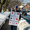 First Parish Church of Fitchburg and Wil Darcangelo and the Tribe hosted the 'Young People's Walk for Love' on the Upper Common in Fitchburg on Tuesday, February 14, 2017. Tony McGregor holds a sign during the event. SENTINEL & ENTERPRISE / Ashley Green