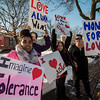 First Parish Church of Fitchburg and Wil Darcangelo and the Tribe hosted the 'Young People's Walk for Love' on the Upper Common in Fitchburg on Tuesday, February 14, 2017. Kassandra Rivera, Sierra Leary, Gabriella Procell and Leona Phaneuf hold signs during the event. SENTINEL & ENTERPRISE / Ashley Green