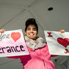First Parish Church of Fitchburg and Wil Darcangelo and the Tribe hosted the 'Young People's Walk for Love' on the Upper Common in Fitchburg on Tuesday, February 14, 2017. Kassandra Rivera, 20,  holds a sign during the event. SENTINEL & ENTERPRISE / Ashley Green