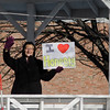 """First Parish Church of Fitchburg and Wil Darcangelo and the Tribe hosted the 'Young People's Walk for Love' on the Upper Common in Fitchburg on Tuesday, February 14, 2017. Deborah Demazure holds a sign that reads """"I Love Honesty."""" SENTINEL & ENTERPRISE / Ashley Green"""