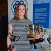 Derbyshire YFC member Kate Wainwright with the NFU cup and the Worshipful members trophy.