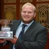 Devon YFC member Jake Henson with the Tug Wilson trophy.