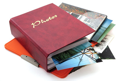 Organize and preserve precious family photos by having them scanned and enhanced with photo editing software