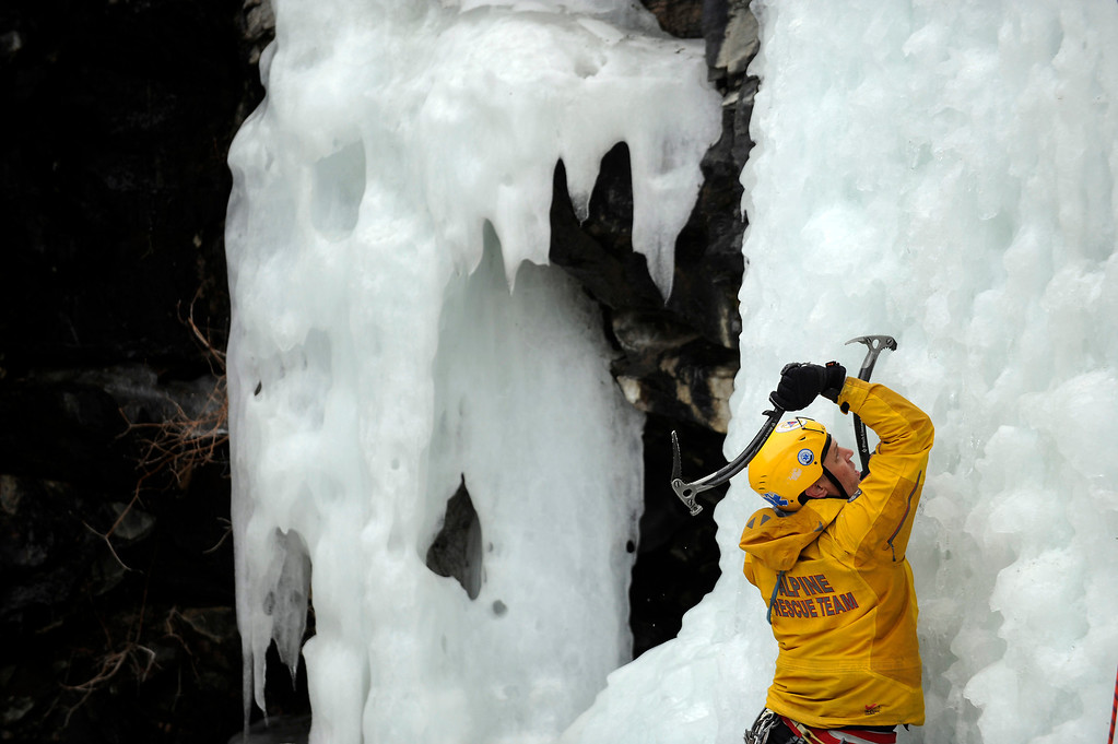 . GOLDEN, CO - FEBRUARY 16: Mark Nelson climbs a frozen water fall during an ice climbing rescue training by the Alpine Rescue Team in Clear Creek Canyon near Golden, Colorado on February 16, 2014. The Alpine Rescue Team is one of a handful of nationally accredited mountain rescue team in Colorado. They specialize in rescue services in hard-to-reach areas and conditions. (Photo by Seth McConnell/The Denver Post)
