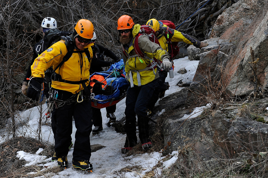 ". GOLDEN, CO - FEBRUARY 16: Members of the Alpine Rescue Team carry out a litter holding the ""victim\"" of an ice climbing accident during an ice climbing rescue training by the Alpine Rescue Team in Clear Creek Canyon near Golden, Colorado on February 16, 2014. The Alpine Rescue Team is one of a handful of nationally accredited mountain rescue team in Colorado. They specialize in rescue services in hard-to-reach areas and conditions. (Photo by Seth McConnell/The Denver Post)"