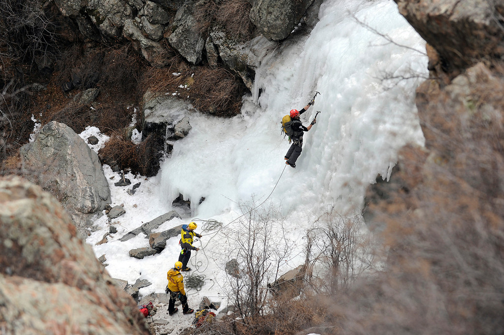 ". GOLDEN, CO - FEBRUARY 16: Alpine Rescue Team Field Director Tom Wood climbs a frozen waterfall as he makes his way up to rescue a ""victim\"" during an ice climbing rescue training by the Alpine Rescue Team in Clear Creek Canyon near Golden, Colorado on February 16, 2014. The Alpine Rescue Team is one of a handful of nationally accredited mountain rescue team in Colorado. They specialize in rescue services in hard-to-reach areas and conditions. (Photo by Seth McConnell/The Denver Post)"