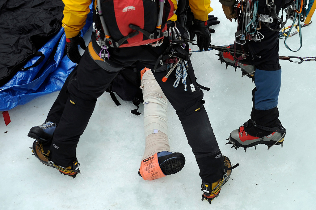 . GOLDEN, CO - FEBRUARY 16: Charlie Adams leg is wrapped with a splint during an ice climbing rescue training by the Alpine Rescue Team in Clear Creek Canyon near Golden, Colorado on February 16, 2014. The Alpine Rescue Team is one of a handful of nationally accredited mountain rescue team in Colorado. They specialize in rescue services in hard-to-reach areas and conditions. (Photo by Seth McConnell/The Denver Post)