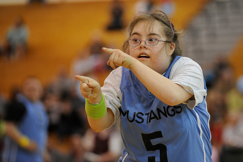 . WESTMINSTER, CO - APRIL 8: Sasha Hernandez (5) of Mountain Range High School pumps up the crowd after her team scored a basket during a unified basketball game at Mountain Range High School in Westminster, Colorado on April 8, 2014. The Adams 12 Five Star Schools Athletic Department and Student Support Services have been working in collaboration with Special Olympics to develop a unified sports program in the district. Each of the district�s five comprehensive high schools has its own basketball team that consists of students with and without disabilities. (Photo by Seth McConnell/The Denver Post)