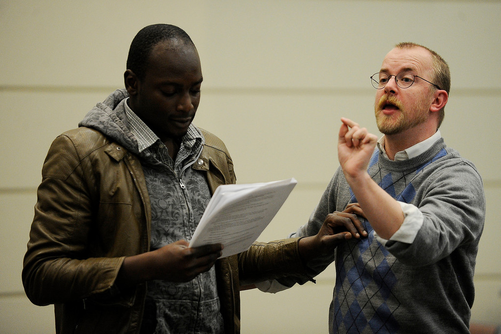 . AURORA, CO - APRIL 16: Aaron Spratte, right, and Banji Osindero rehearse a scene from The Music of Change at the Community College of Aurora Fine Arts Building in Aurora, Colorado on April 16, 2014. Aaron Spratte is an Aurora resident who wrote the play The Music of Change about grief and mourning that was presented as a student practicum when he was 18. After a successful kickstarter project that closed last year, Aaron is ready to present his 11-year-old piece at the Aurora Fox for a full month in May. (Photo by Seth McConnell/The Denver Post)