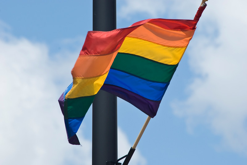 A rainbow pride flag waves in the wind at the Chicago Gay Pride Parade.