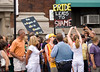 Two protestors march through crowds at the Chicago Gay Pride Parade, mostly to the amusement of disagreeing festival onlookers.