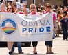 Supporters of Senator Barack Obama, a popular Democratic presidential candidate in the gay community, march with a banner in the Chicago Gay Pride Parade.