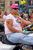 A woman from the Dykes on Bikes motorcycle club rides down the parade route at the Chicago Gay Pride Parade.