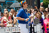 Woman playing drums in a gay marching band in the Chicago Gay Pride Parade.