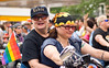 Two women from the Dykes on Bikes motorcycle club ride down the parade route at the Chicago Gay Pride Parade.