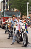 Women from the Dykes on Bikes motorcycle club ride down the parade route, followed by the Chicago Fire Department, in the Chicago Gay Pride Parade.