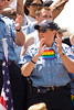 Cihcago police officers stand among the spectators at the Chicago Gay Pride Parade.