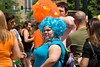 Young woman and man wear colorful wigs at the Chicago Gay Pride Parade and festival.