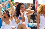 Performers from the Baton Club wave at spectators in the Chicago Gay Pride Parade. The Baton Club is a well-known cabaret venue where most of the performers are transexuals, transvestites, o ...