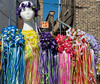 Decorative head wreaths made of fake flowers and ribbons for sale. May Fest Chicago is produced by a German group known as the Mardi Gras Society in the Lincoln Square neighborhood in Chicago, Illinois. The festival promotes German culture, including food, dance, music, and traditional clothing.