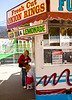 Young girl waits with anticipation while mother gets money to purchase a snack at a concession stand at the Tulip Time Festival in Holland, Michigan