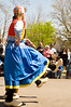 Dancers in traditional Dutch costumes and wooden shoes perform a klompen dance for audience at the Tulip Time Festival in Holland, Michigan