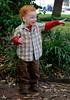 Savannah, Georgia. Historic District, Chippewa Square. Toddler boy enjoying street musician.