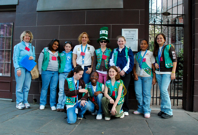 Savannah, Georgia. Girl Scouts posing for group photo outside gates of First Girl Scouts Headquarters, founded by Juliette Gordon Low.