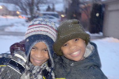 Two children in winter clothing