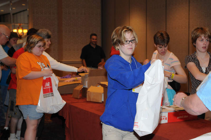 Servant Encounter - stuffing bags for Jazz Half Marathon, sponsored by Children's Hospital