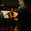 MYLE's house band preparing music for worship.