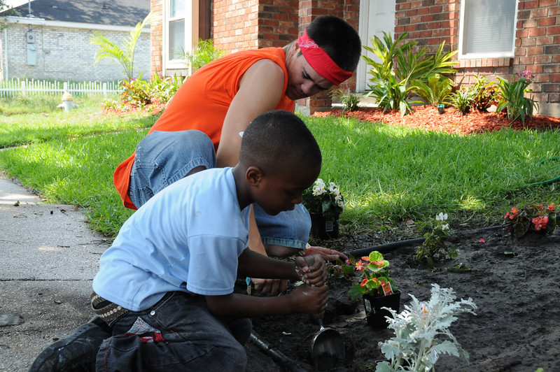 service project - helping community w/ painting and gardening at homes; trash pickup