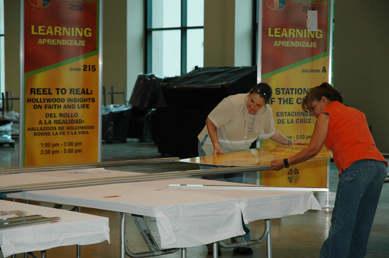 Voluteers work on assembling the signage that will help attendees find their way around the Henry B. Gonzalez Convention Center.