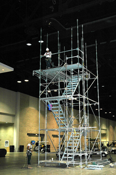 "Ready to Climb? Workers assemble the tower for the ropes course, the centerpiece for ""El Puente,"" the Interaction Center located in the Henry B. Gonzalez Cenvention Center."