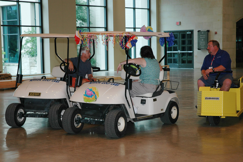 """If this is a cart race, I'd say the yellow one is losing. Paul Hill, Team Leader for """"El Puente,"""" the Interaction Center located in the Henry B. Gonzalez Convention Center, speaks with an unidentified volunteer and a convention center employee."""