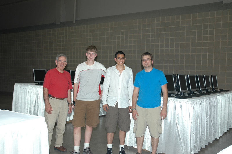 """Gil, Aaron, Charles, and Carter pause from setting up the Lonestar Cafe, one of many internet access points for visitors to  """"El Puente,"""" the Interaction Center located in the Henry B. Gonzalez Convention Center."""