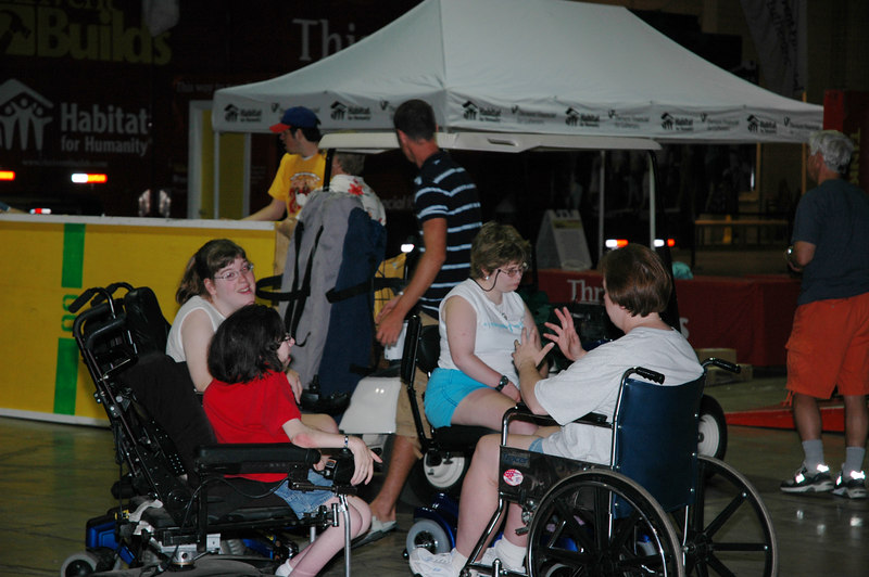"""Members of the Definitely-Abled Advisory Commitee oversee the assembly of """"Tinkletown,"""" an informative interactive obstacle course that teaches awareness of everyday challenges those in wheelchairs must face."""