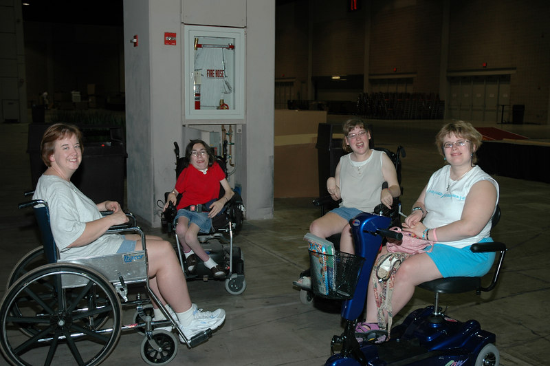 """Members of the Definitely-Abled Advisory Committee pause for a moment during the assembly of """"Tinkletown,"""" an informative interactive obstacle course that teaches awareness of everyday challenges those in wheelchairs must face."""